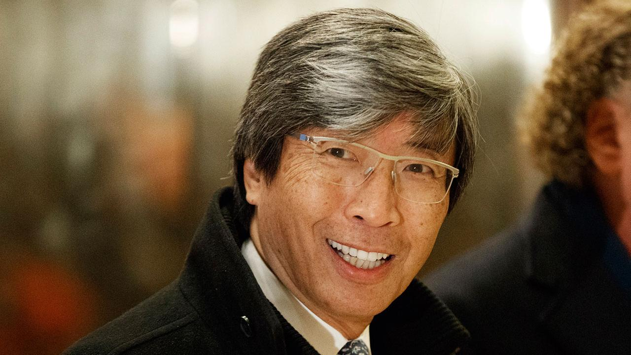 FILE - In this Jan. 10, 2017, photo, billionaire Dr. Patrick Soon-Shiong waves as he arrives in the lobby of Trump Tower for a meeting with President-elect Donald Trump.