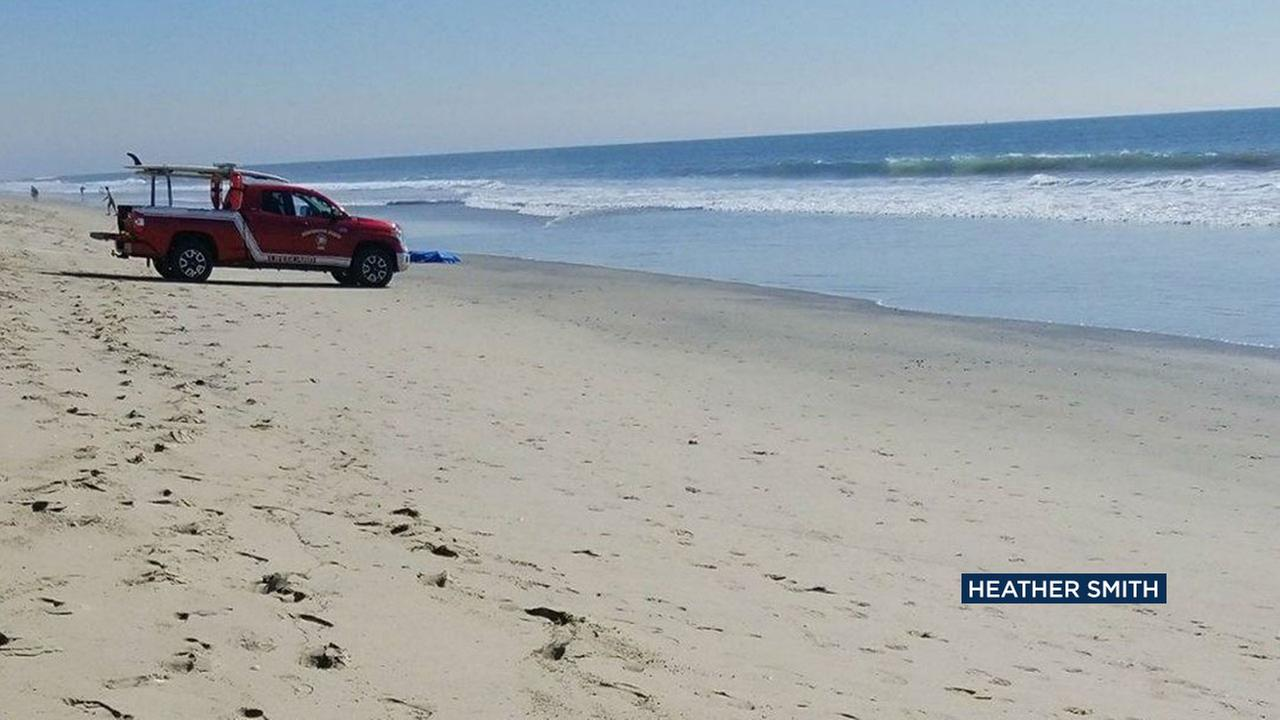 An unidentified body was found near the Huntington Beach pier Thursday afternoon and officials are looking to determine if they have found a woman who went missing Wednesday.