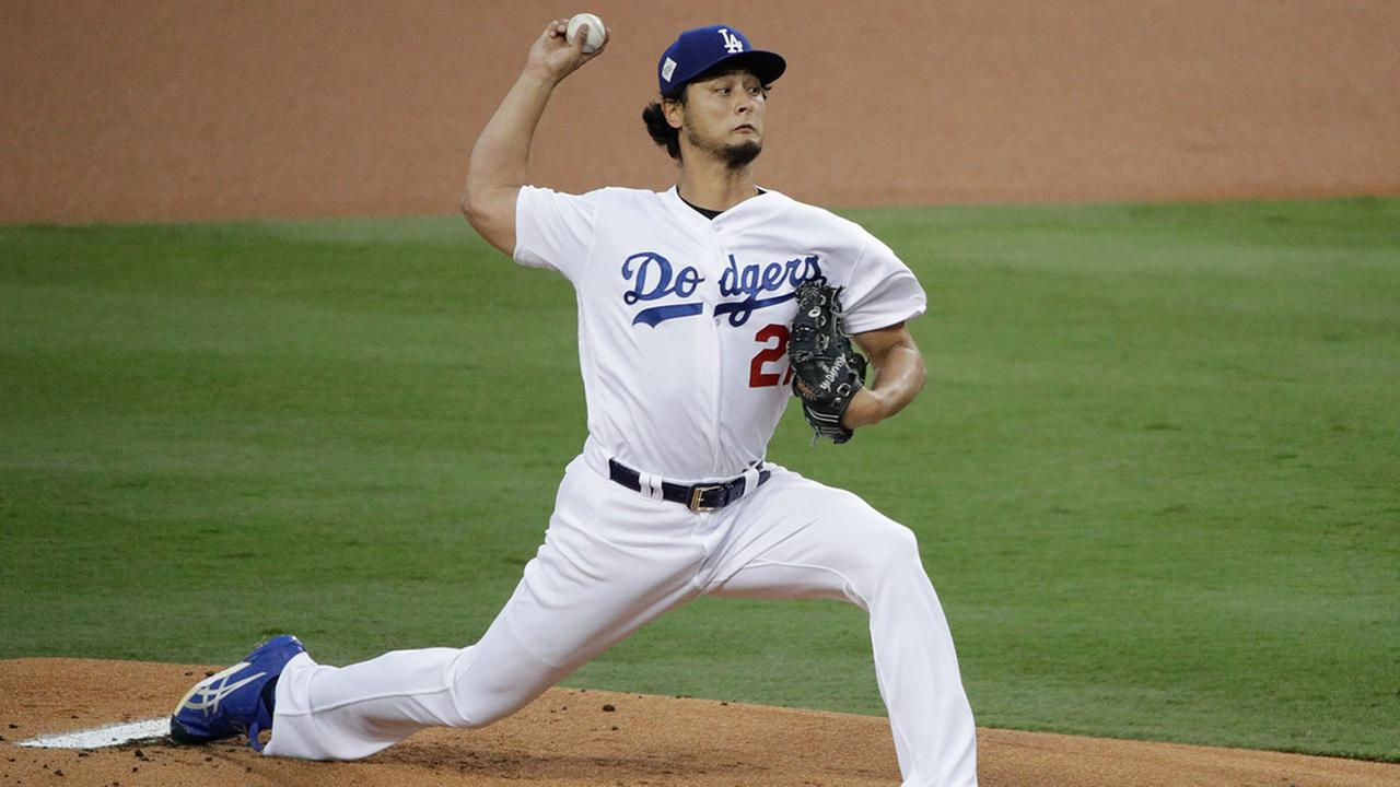 FILE - In this Nov. 1, 2017, file photo, Dodgers pitcher Yu Darvish, of Japan, throws against the Houston Astros during the first inning of Game 7 of baseballs World Series in LA.