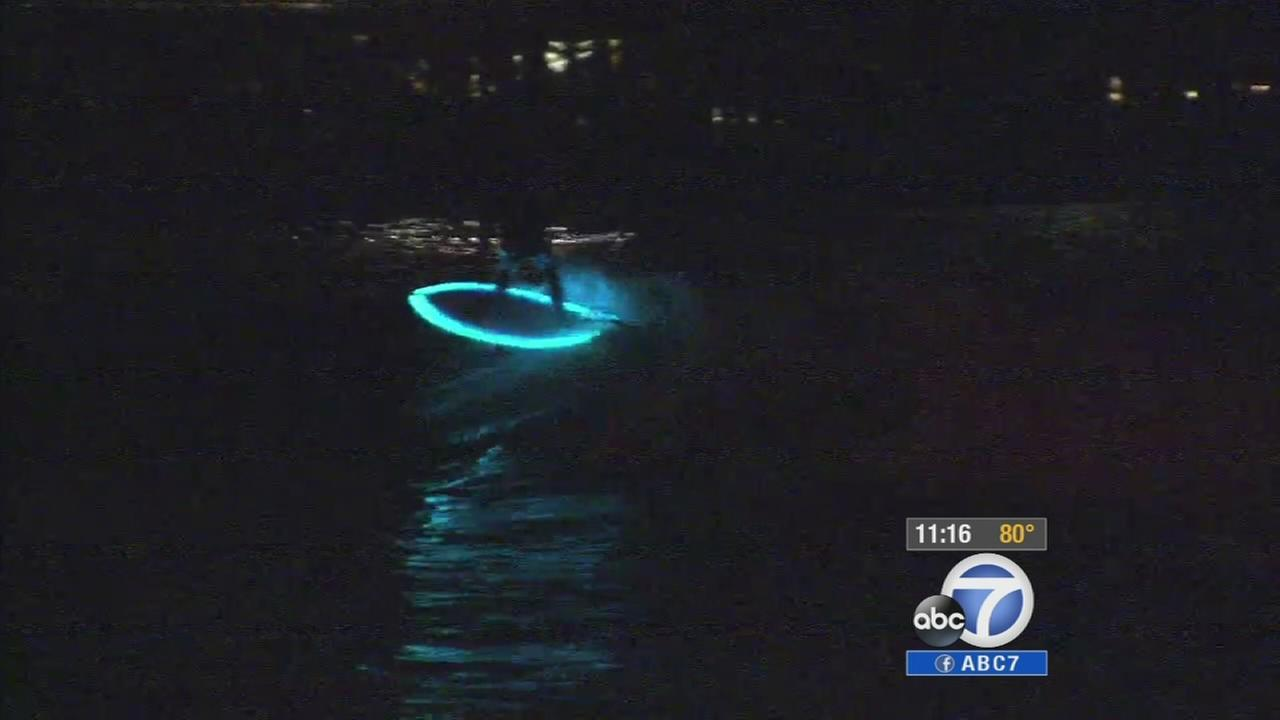 A local man has created a surf board equipped with LED lights designed to illuminate waves in the dark.