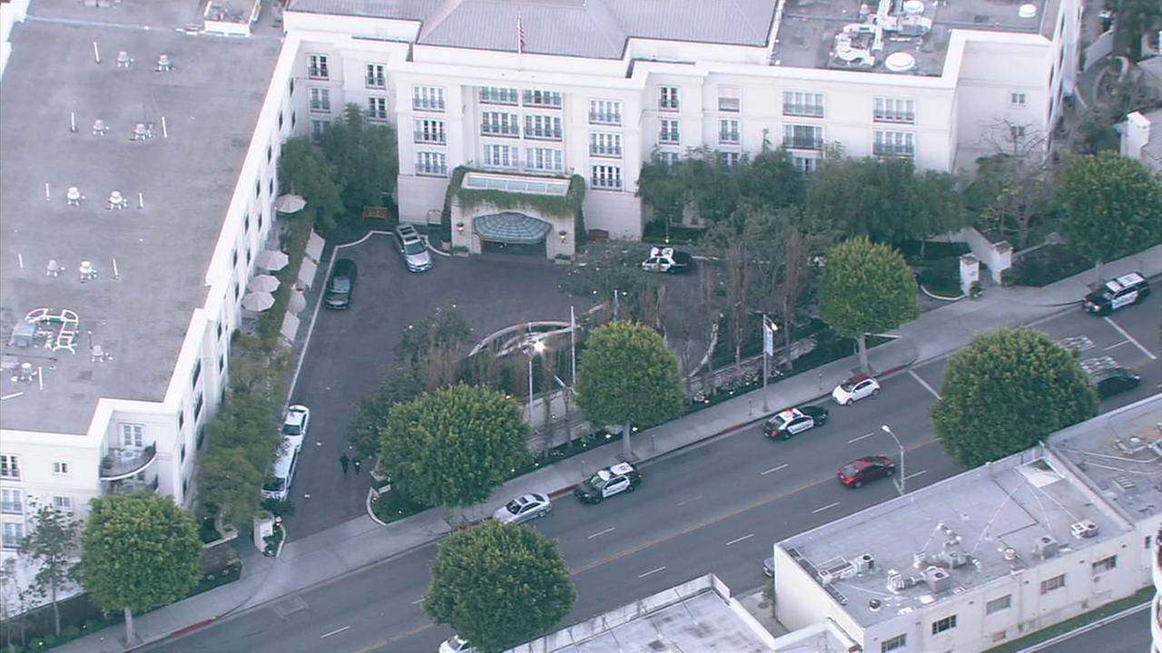 Police vehicles are seen outside the Peninsula Beverly Hills hotel on Thursday, Feb. 22, 2018.