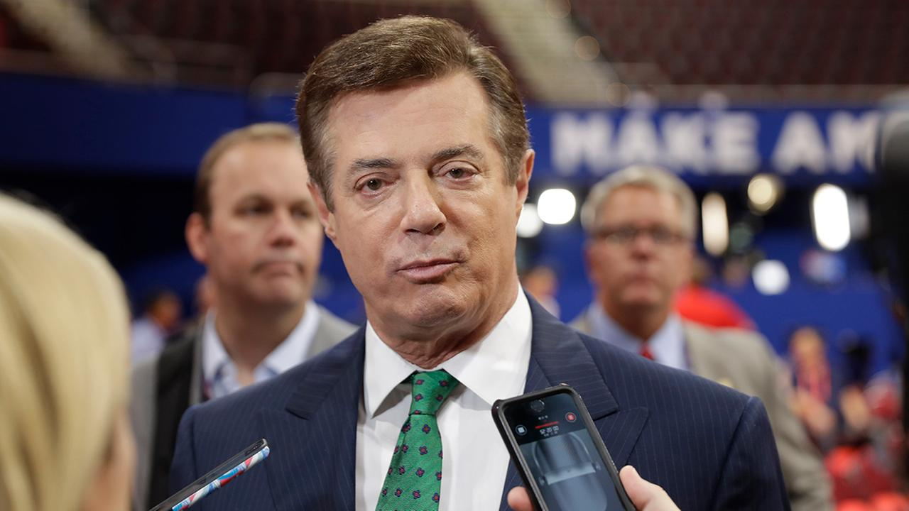 In this July 17, 2016 file photo, Paul Manafort talks to reporters at the Republican National Convention in Cleveland as Rick Gates listens at back left. (AP Photo/Matt Rourke)