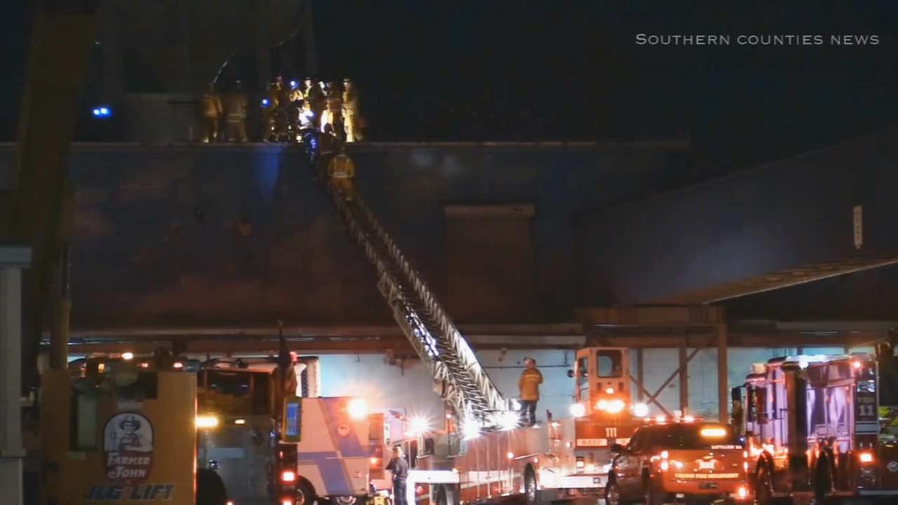 A man in his 40s died after being rescued from the roof of a Farmer John property in Vernon Tuesday night, Sept. 16, 2014.