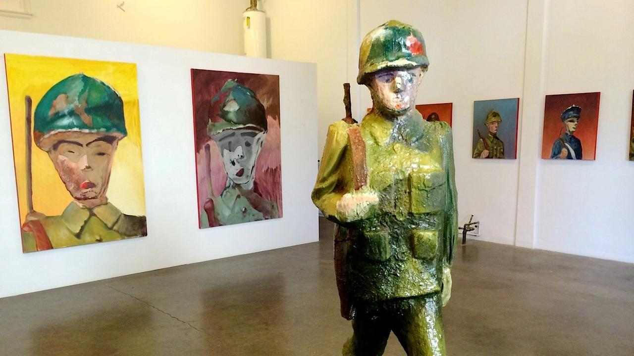 Paintings and sculpture inspired by toy soldiers on view at Red Pipe Gallery in Chinatown.