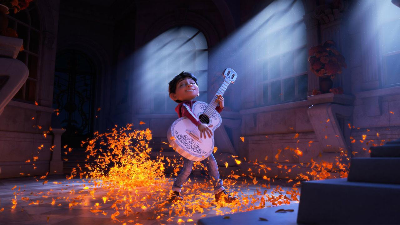 Miguel from Pixars Coco is shown playing a guitar in an image from the animated movie.