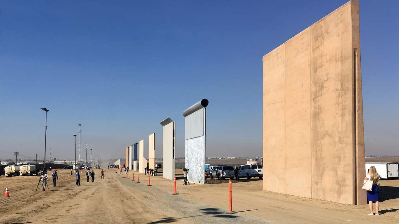 In this undated photo, workers put finishing touches on border wall prototypes ordered by President Donald Trump.