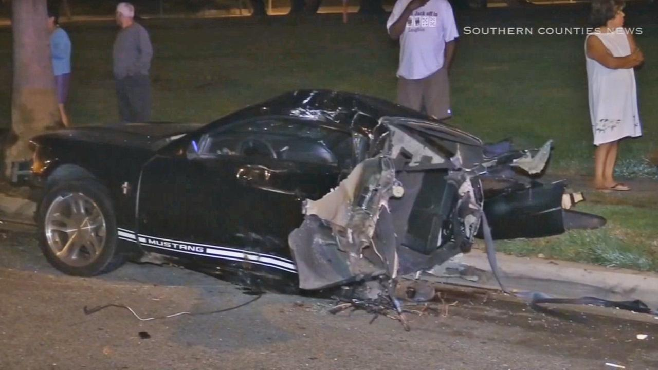 A Ford Mustang was split in half in a collision with an SUV early Friday morning next to Athens Park in South Los Angeles, Sept. 19, 2014.