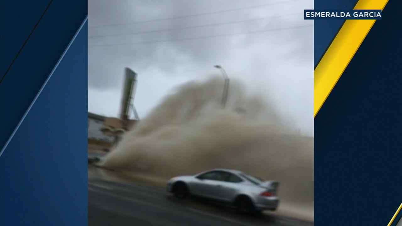A witness captures a massive eruption of water after a water main breaks along La Brea Avenue in Mid-City on Friday, March 2, 2018.