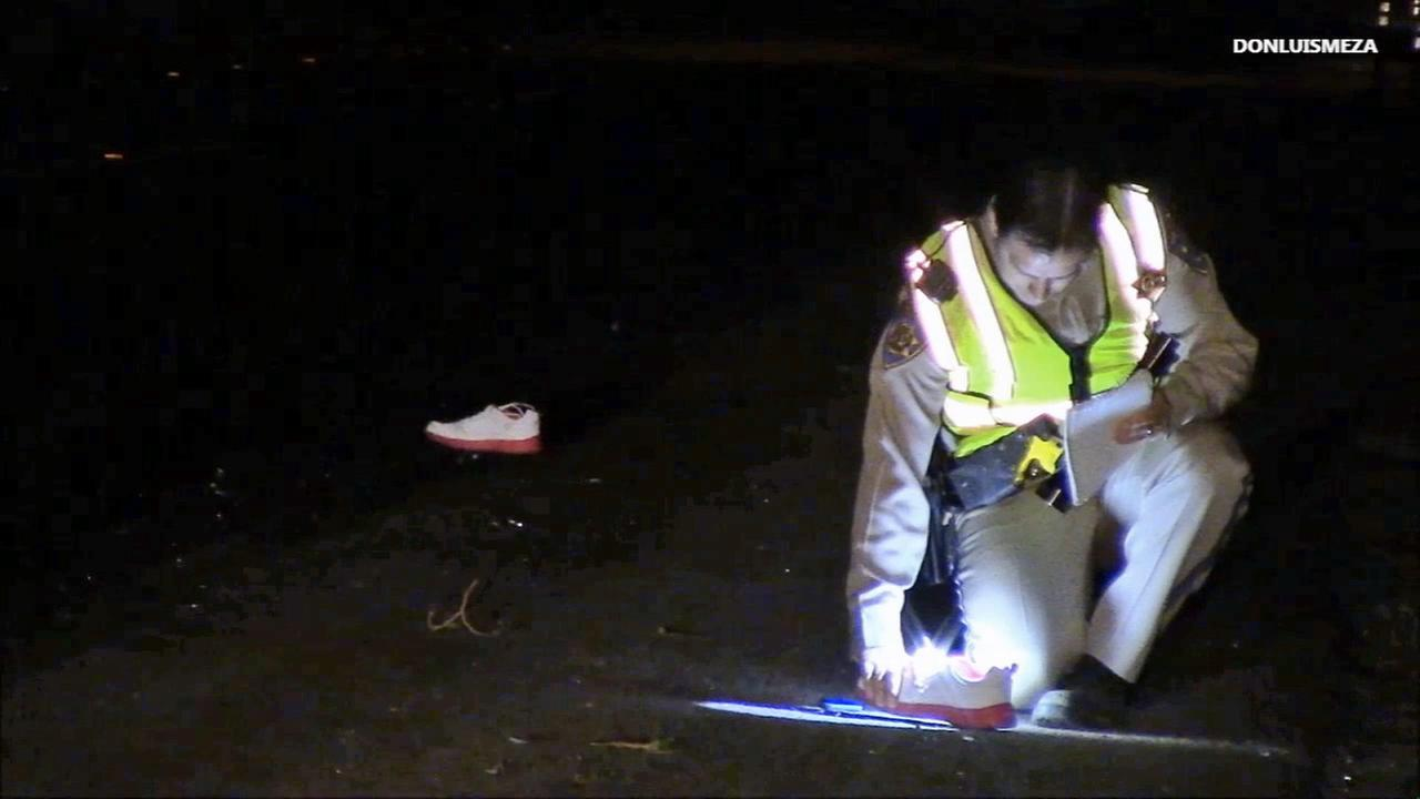 Police investigate a hit-and-run that killed a pedestrian in Littlerock on Saturday, Sept. 20, 2014.