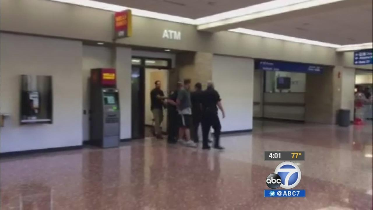 A man attempted to open the exit door on a Los Angeles-bound Virgin America flight after experiencing a mental episode while on drugs.