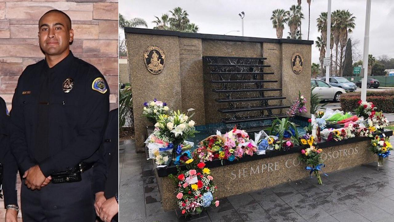 Pomona Officer Greggory Casillas, 30, of Upland, is shown in a photo alongside a memorial created for him outside the Pomona Police Department.