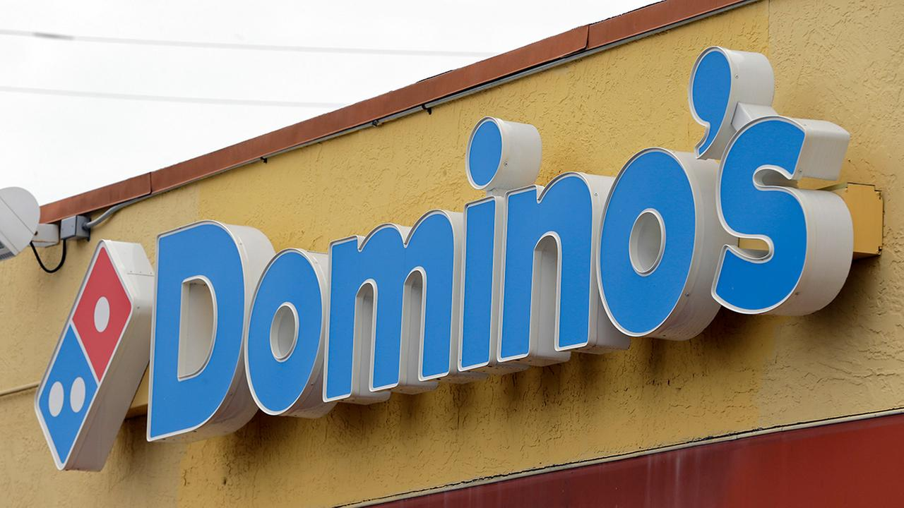 This Thursday, Oct. 27, 2016, photo shows a Dominos Pizza sign at a location in Hialeah, Fla.