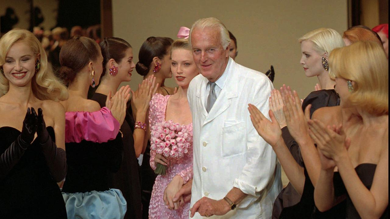 French designer Hubert de Givenchy is applauded by his models after his 1995-96 fall-winter haute couture fashion collection in Paris, Tuesday July 11, 1995.