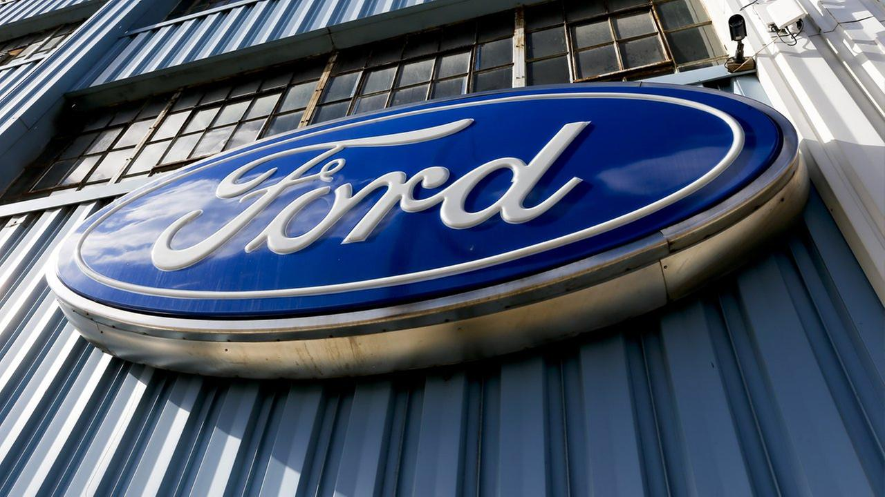 This Thursday, Nov. 19, 2015, photo, shows a blue oval Ford sign above the entrance to Butler County Ford in Butler, Pa.