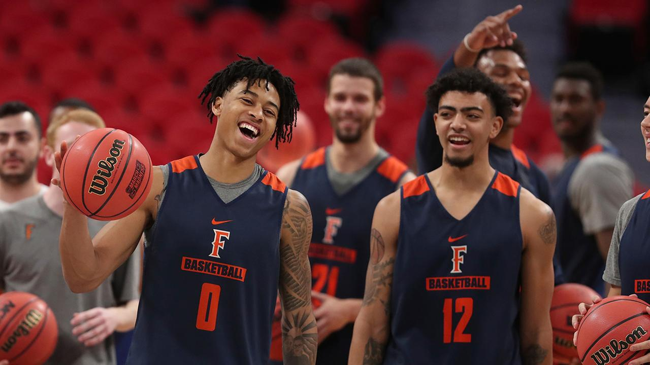Cal State Fullerton Titans guards wait to shoot from mid-court during a practice for an NCAA mens basketball tournament first-round game, Thursday, March 15, 2018, in Detroit.