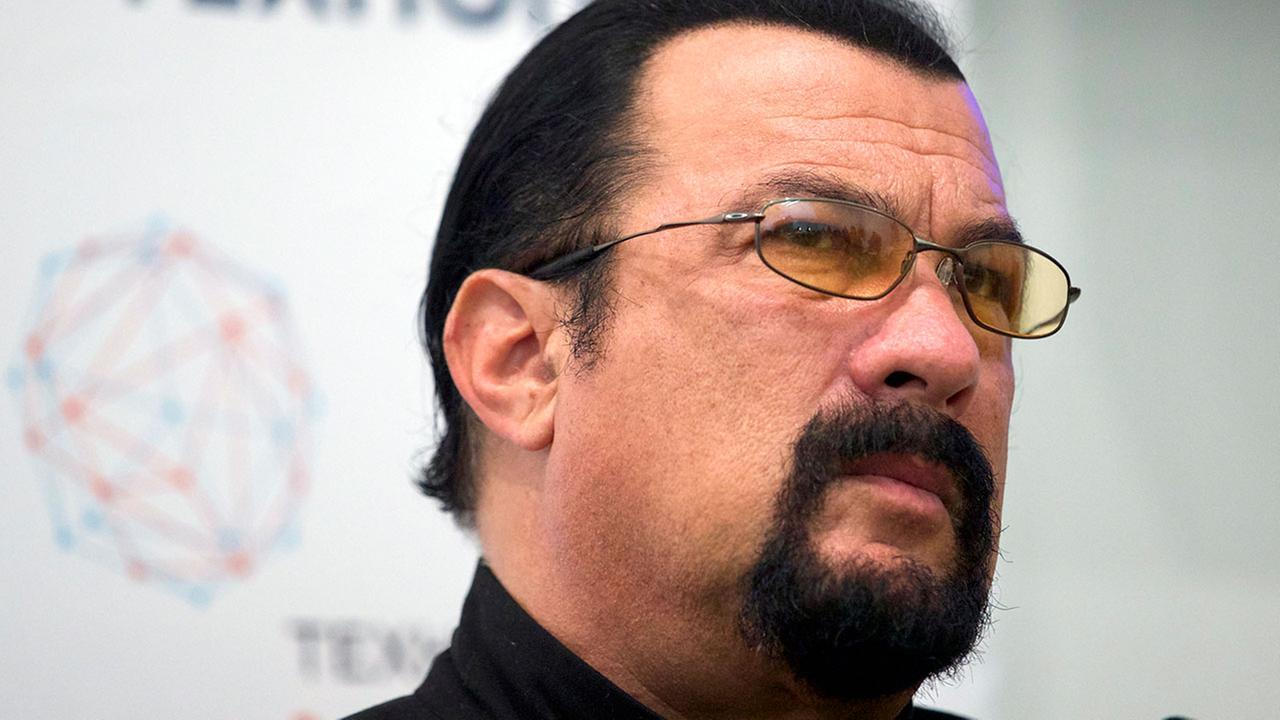 FILE - In this Sept. 22, 2015, file photo, actor Steven Seagal speaks at a news conference, while attending an opening ceremony for a research and development center in Moscow.