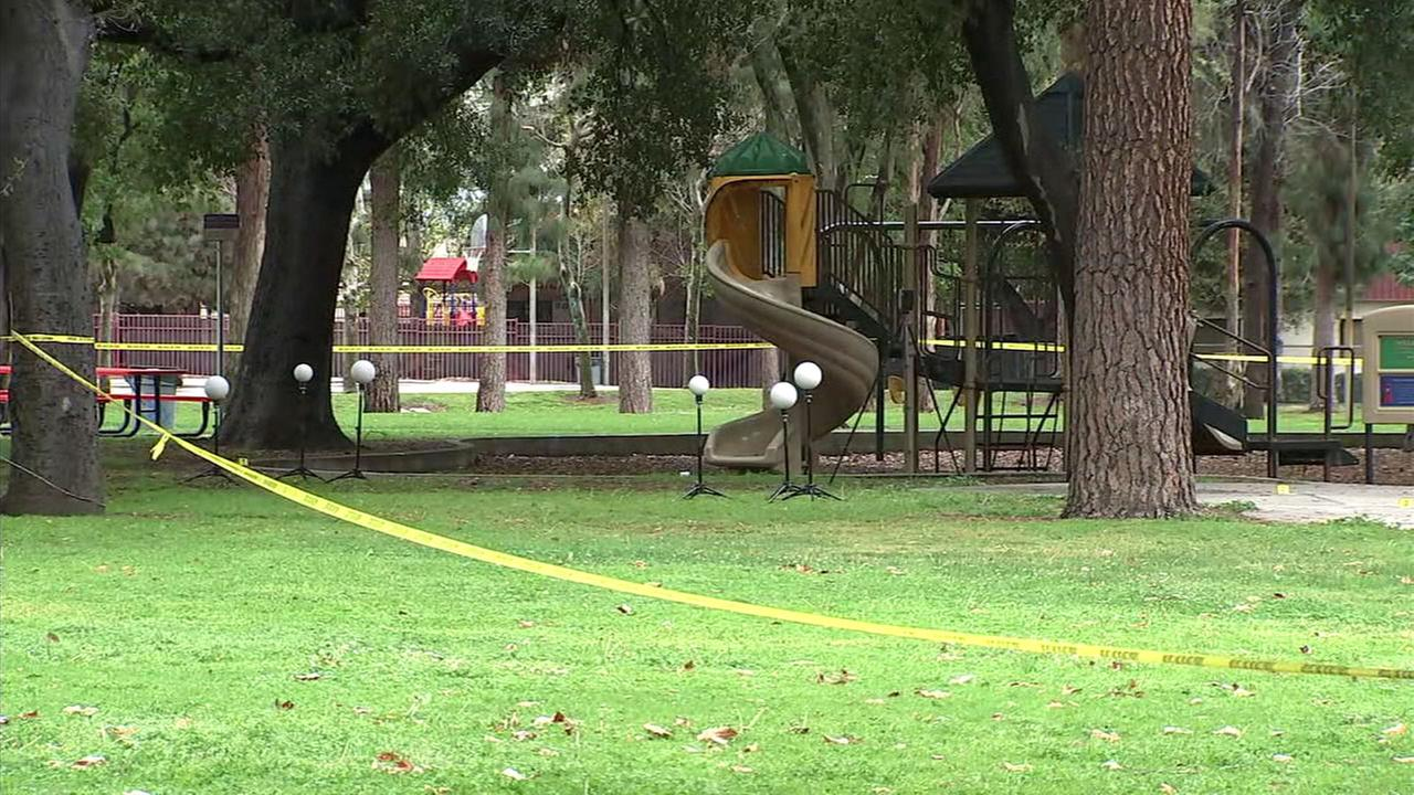 Crime tape surrounds a bloody scene at an Upland park on Wednesday, March 21, 2018. Police are investigating whether the scene is connected to a mans death at a nearby apartment.