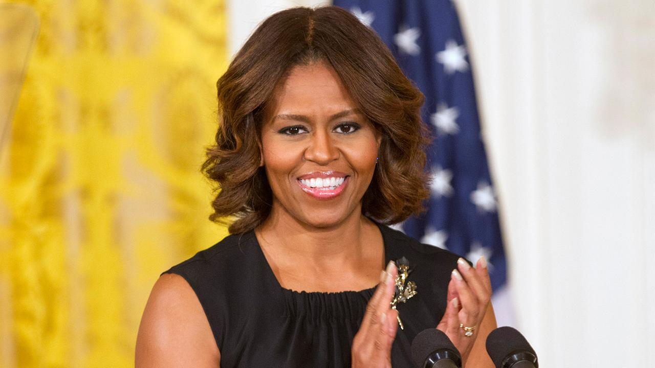 First lady Michelle Obama applauds in the East Room of the White House in Washington, Wednesday, June 4, 2014.