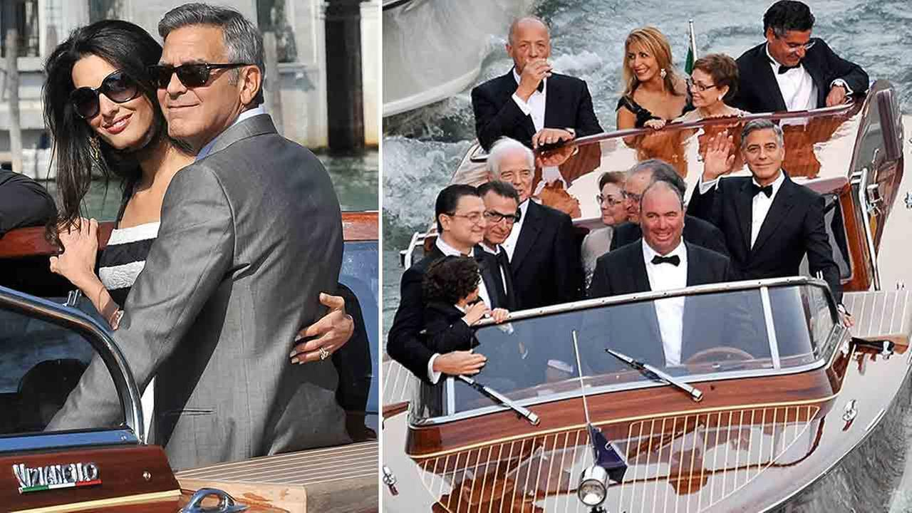 Actor George Clooney waves from a boat on his way to the Aman hotel ahead of his wedding in Venice, Italy, Saturday, Sept. 27, 2014.