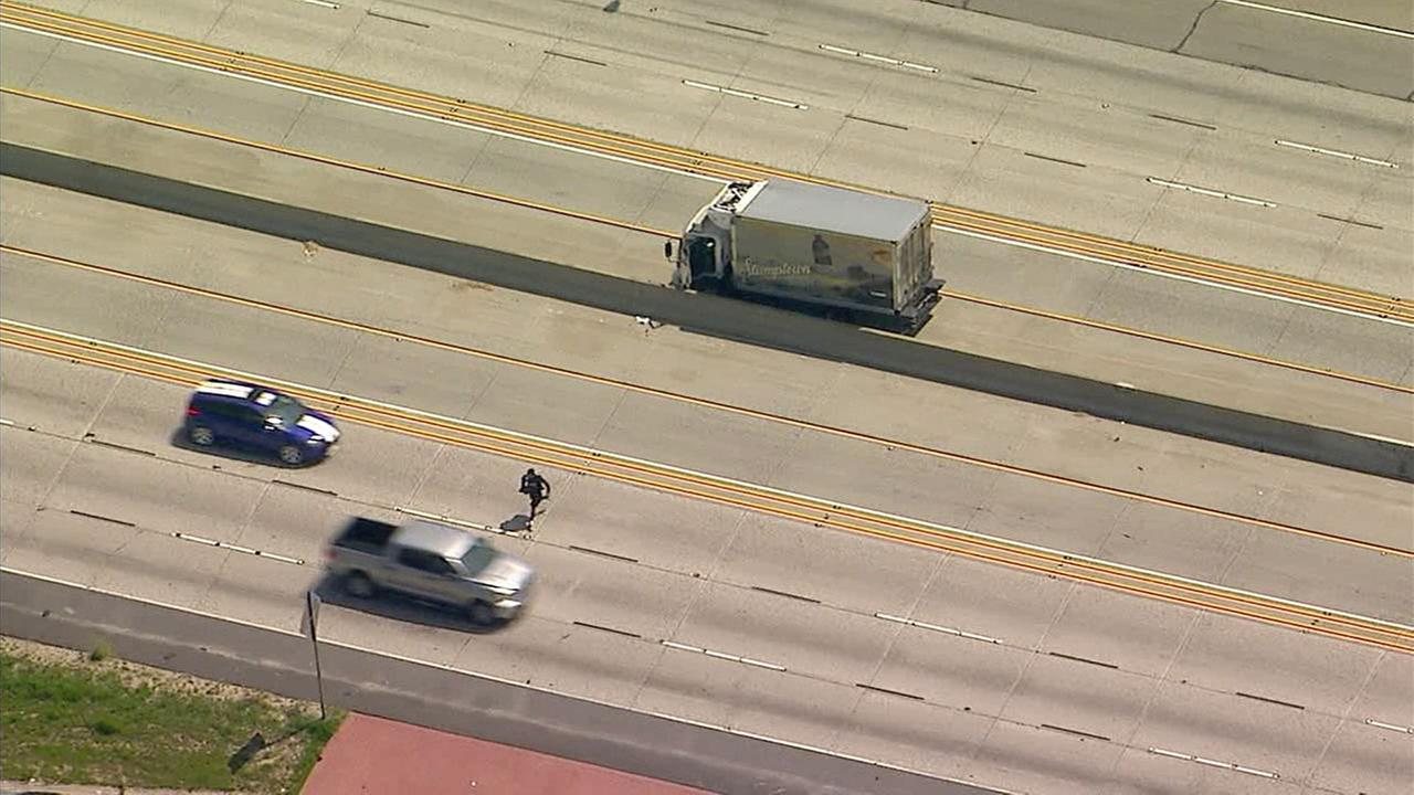 A chase suspect bolts out of a box truck after a chase in the Santa Clarita area, narrowly missing oncoming traffic, before getting arrested on Monday, April 2, 2018.