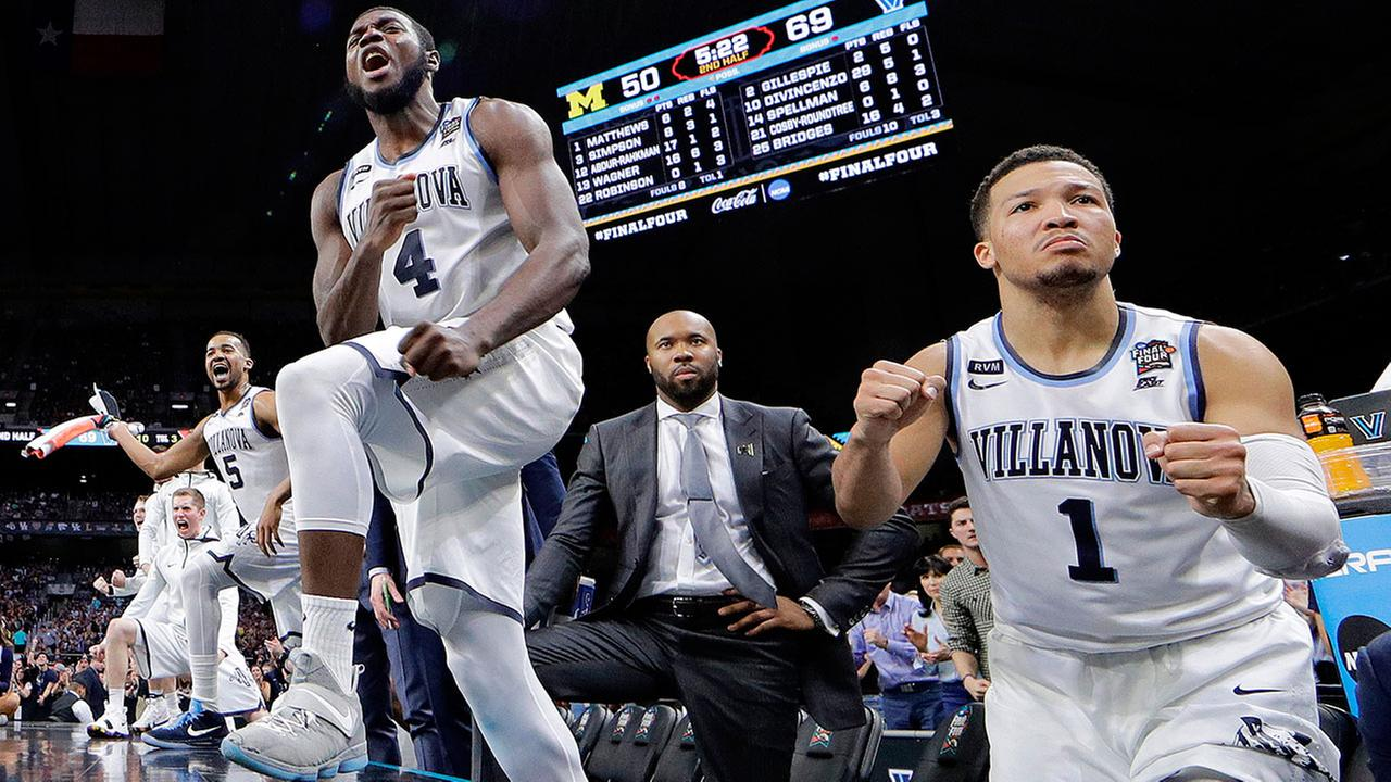 Villanovas Jalen Brunson (1) and Eric Paschall (4) react during the championship game of the NCAA college basketball tournament against Michigan, in San Antonio.
