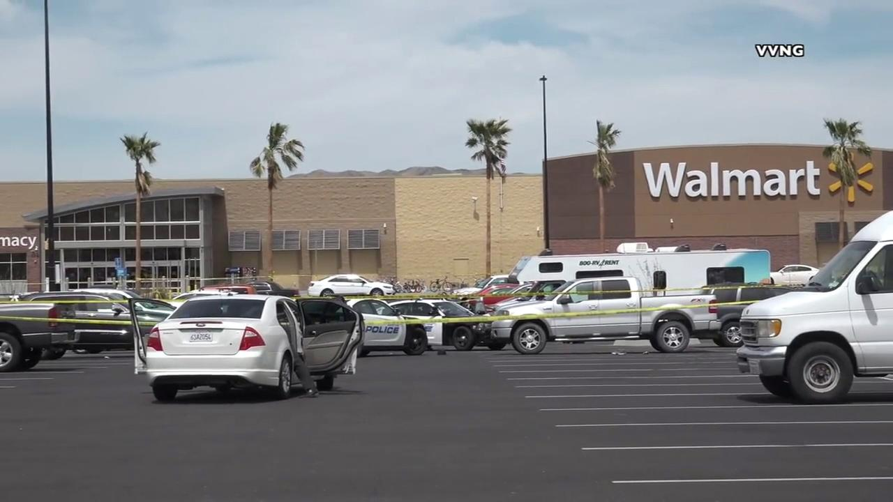 Investigators are seen in the parking lot of a Walmart in Barstow after an officer-involved shooting on Thursday, April 5, 2018.