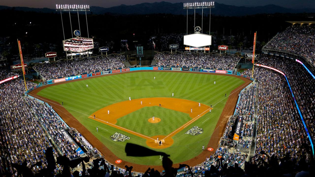 In this Oct. 25, 2017, file photo, the Houston Astros and the Los Angeles Dodgers play in Game 2 of the baseball World Series at Dodger Stadium in Los Angeles.