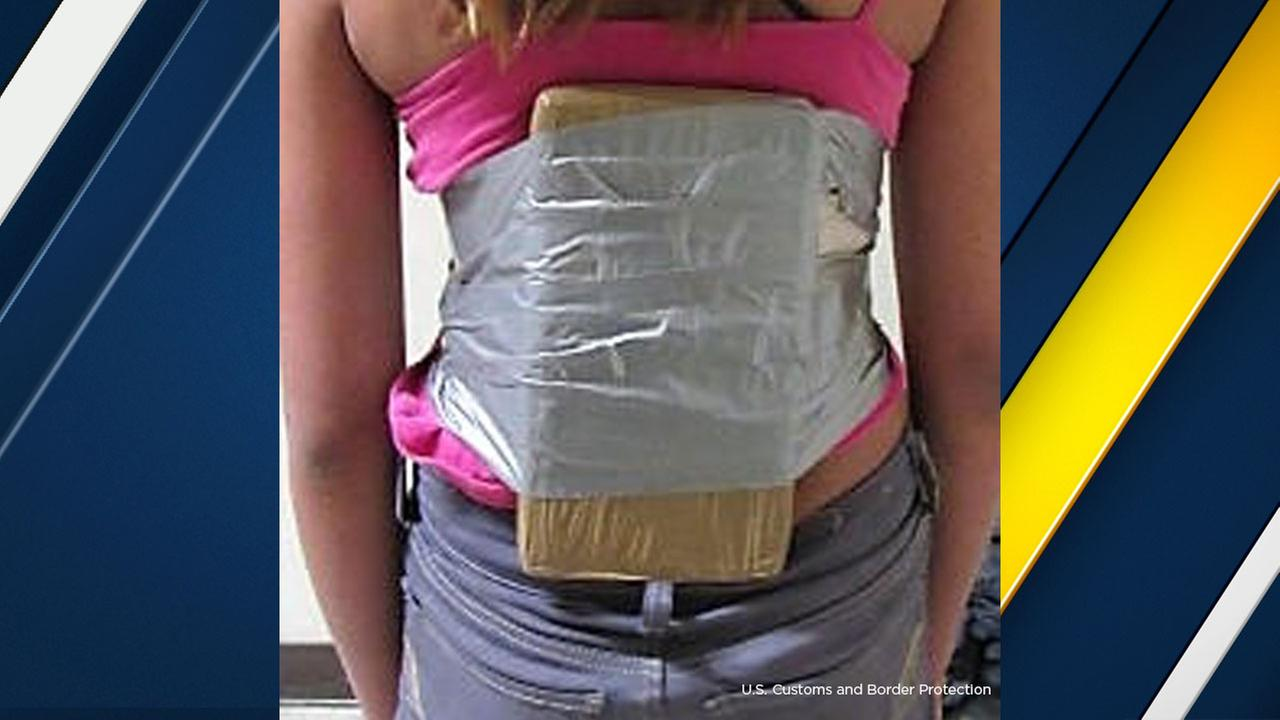 A 12-year-old girl seen with 2 pounds of cocaine wrapped around her torso.