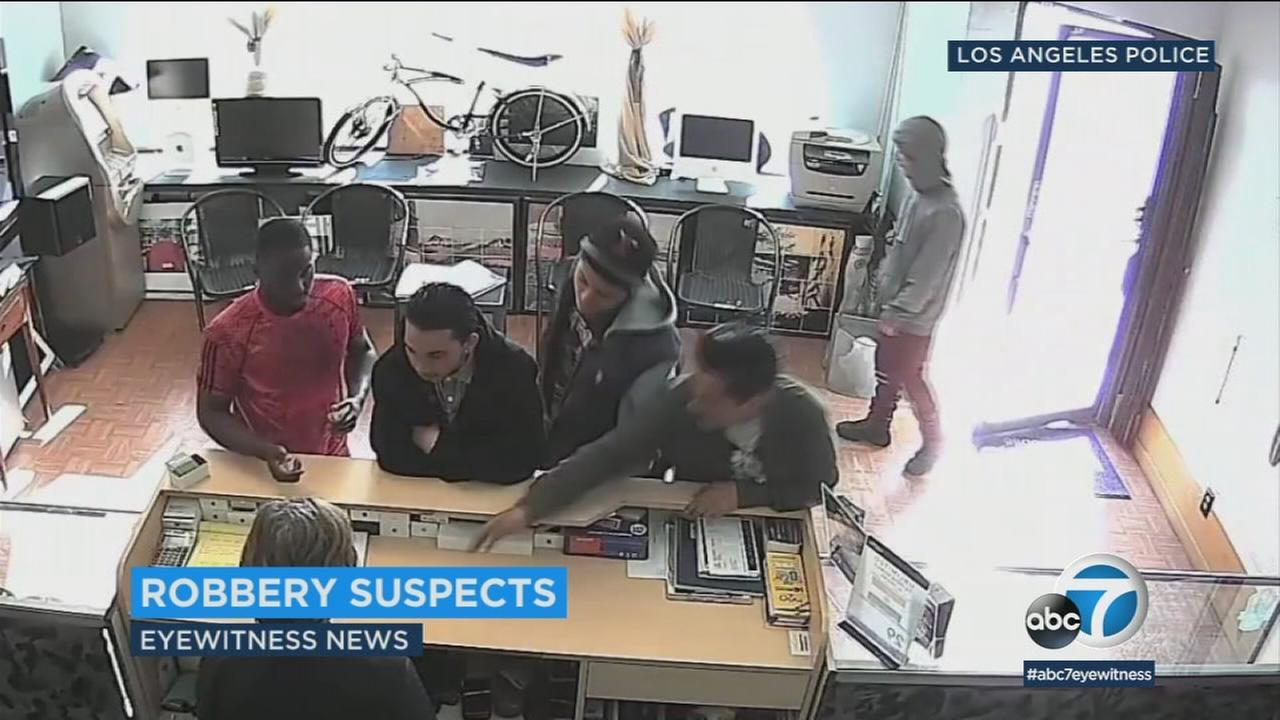 Surveillance video shows five suspects who police say later robbed someone on the streets of Venice.