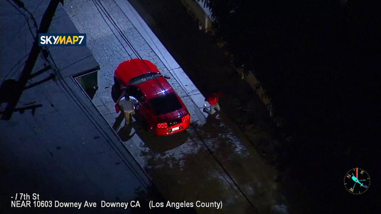 Two chase suspects, a driver and passenger, exited a red Mustang in a Downey alleyway and surrendered to police on Friday, May 4, 2018.