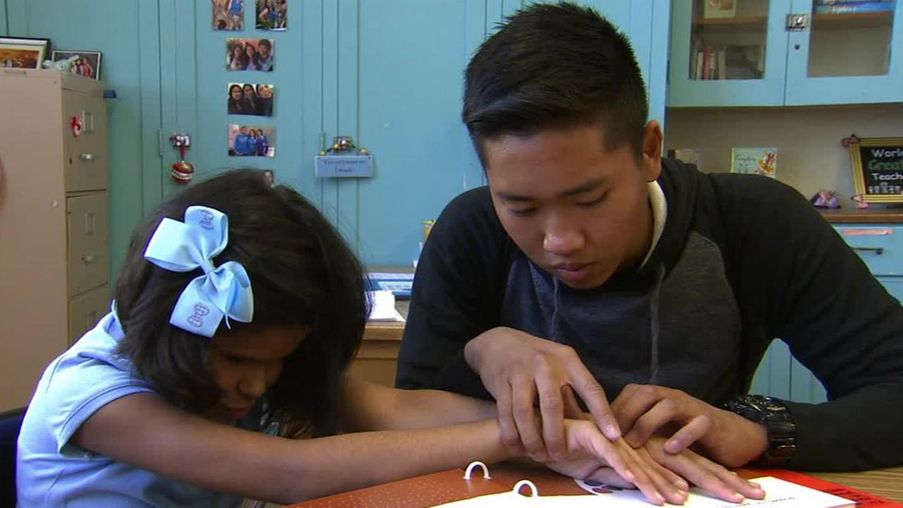ABC7 Cool Kid John Ronquillo volunteers with a visually impaired student in this undated file photo.