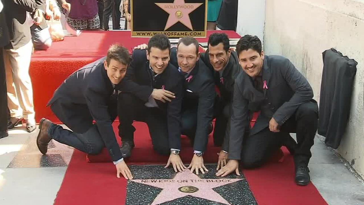 Pop group New Kids on the Block gather around their Hollywood Walk of Fame star on Thursday, Oct. 9, 2014.