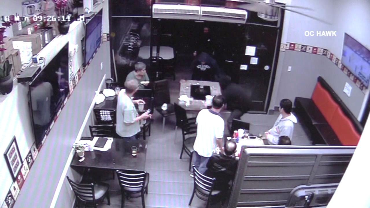 Westminster police are looking for four suspects who robbed a gaming table from a cafe in Little Saigon.