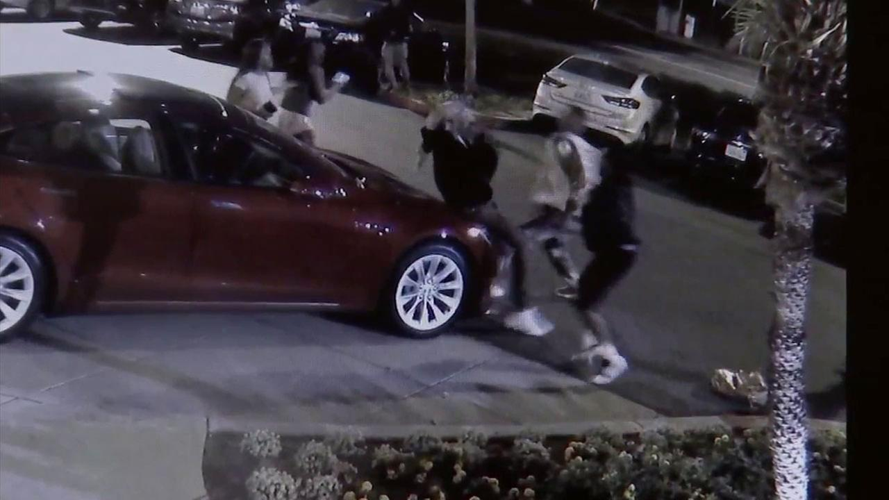A group of men attacked two people in an El Segundo parking lot and stole a backpack and some jewelry.