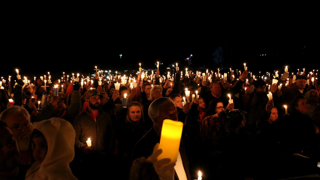 People attend a vigil for the victims of a fatal shooting at Marshall County High School on Thursday, Jan. 25, 2018, at Mike Miller County Park in Benton, Ky.
