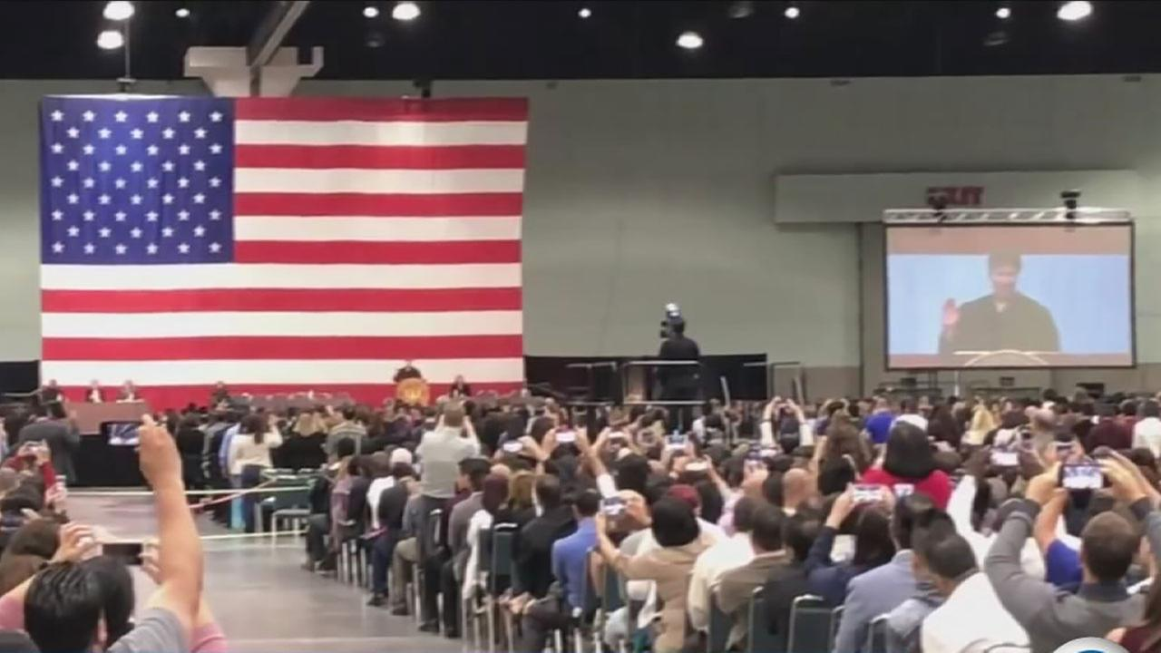 Thousands of foreigners were sworn in as American citizens during a Wednesday ceremony in downtown Los Angeles.