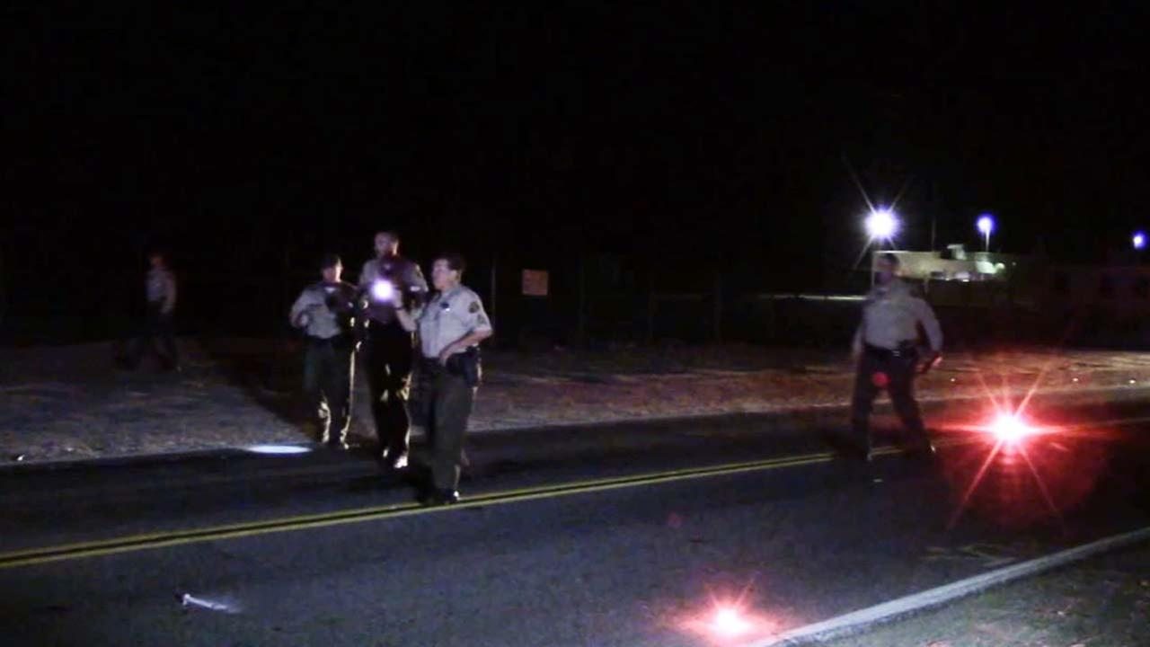 Law enforcement officials investigate a scene of a fatal hit-and-run crash in Littlerock, Calif. on Oct. 15, 2014.
