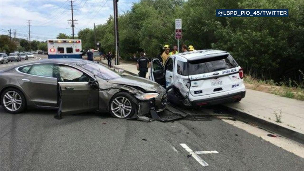 A Tesla sedan in autopilot mode crashed into a parked police vehicle in Laguna Beach, police said.