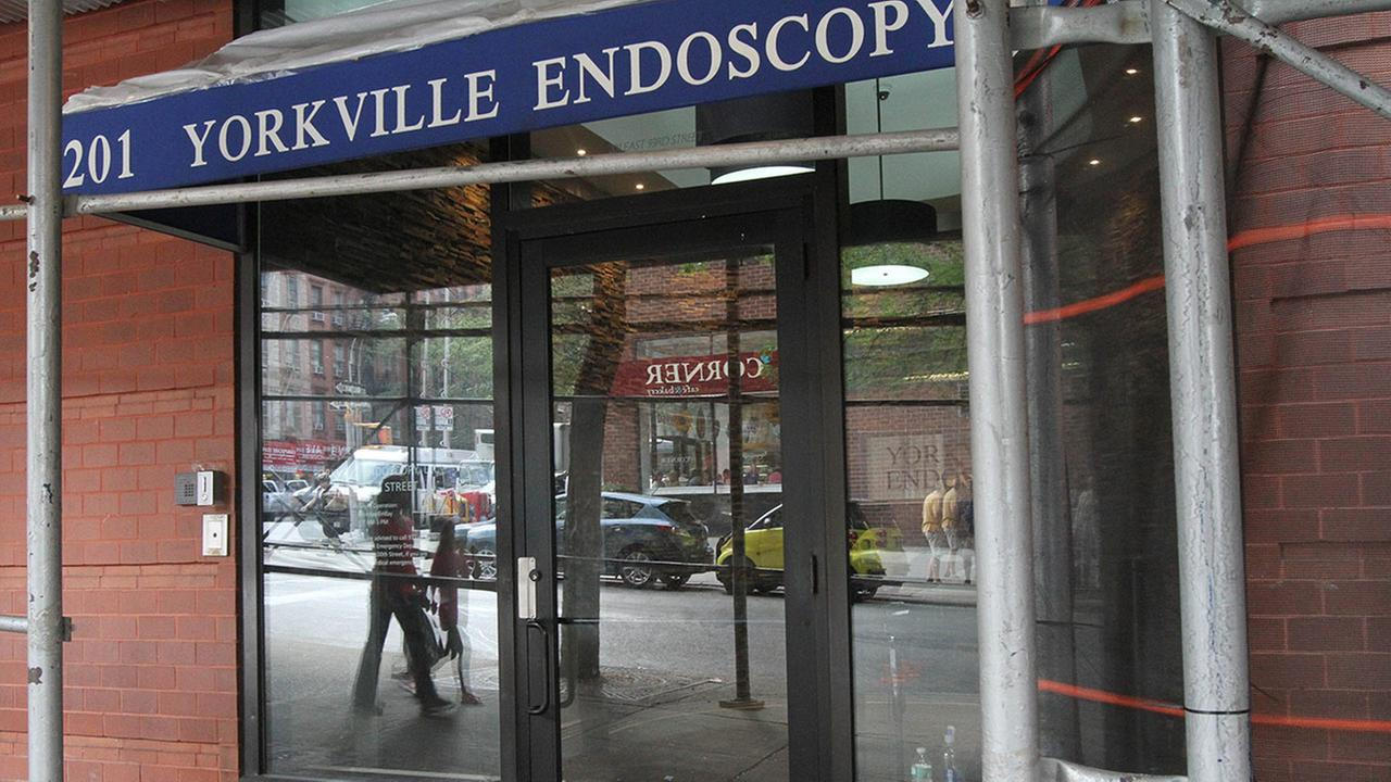 The reflections from the street are seen in the window of Yorkville Endoscopy in New York, Friday, Sept. 5, 2014.