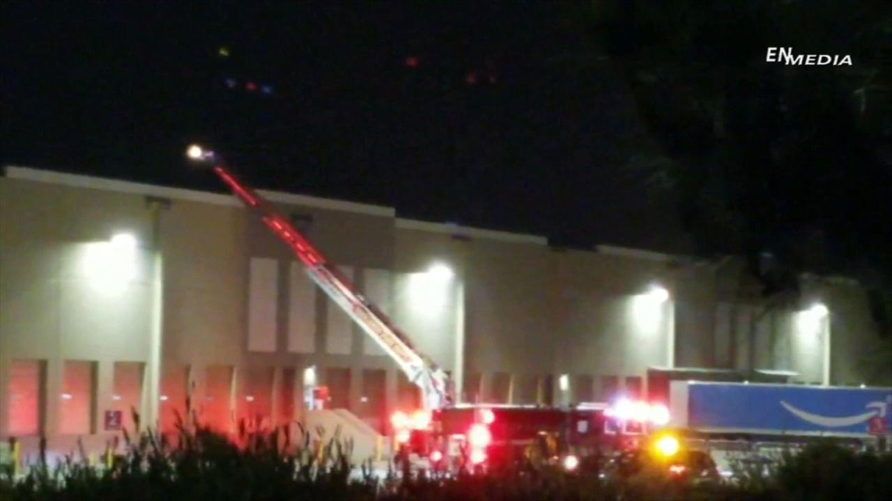 Firefighters at the scene of a fire at the Amazon Fulfillment Center in Redlands on Tuesday, June 5, 2018.