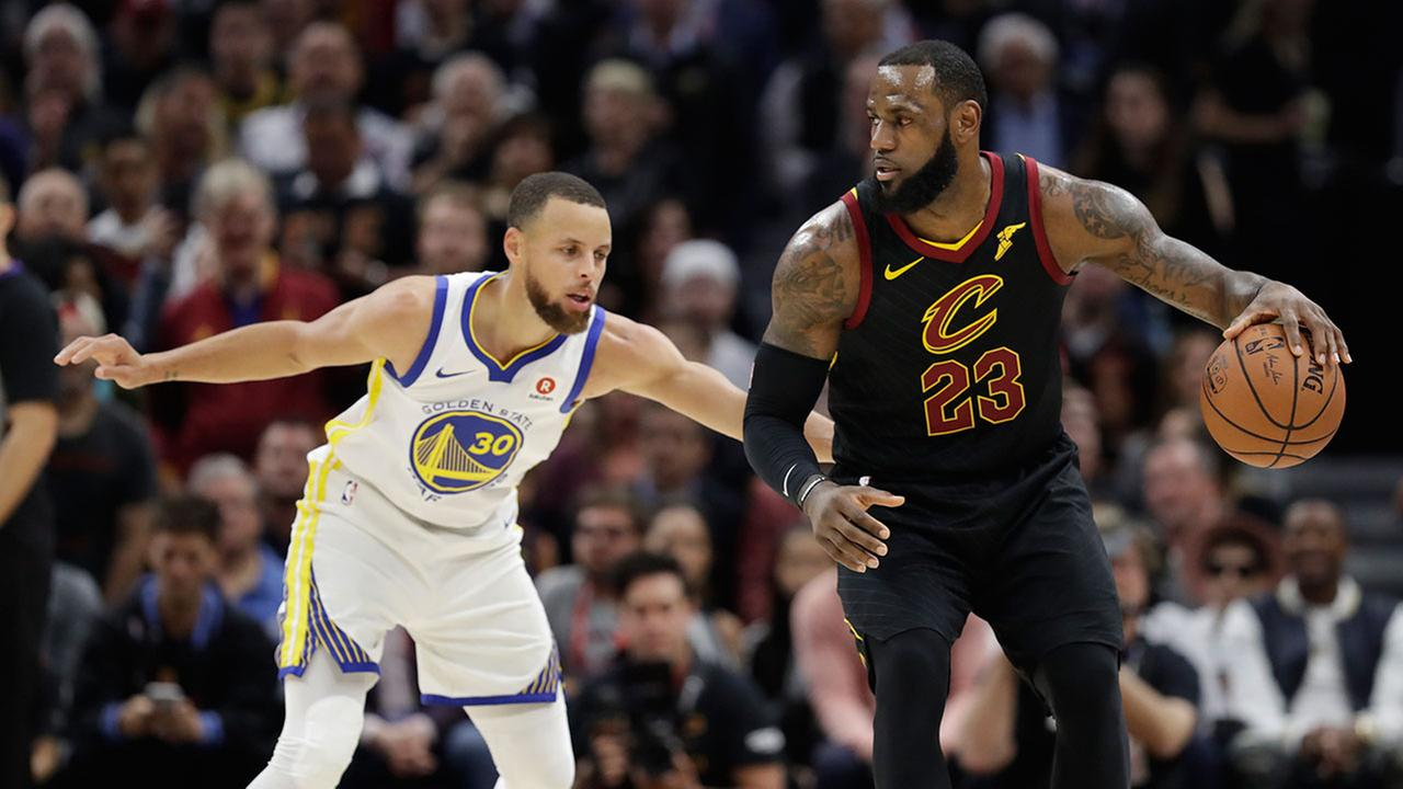 Cleveland Cavaliers LeBron James is defended by Golden State Warriors Stephen Curry during Game 3 of the NBA Finals in Cleveland.