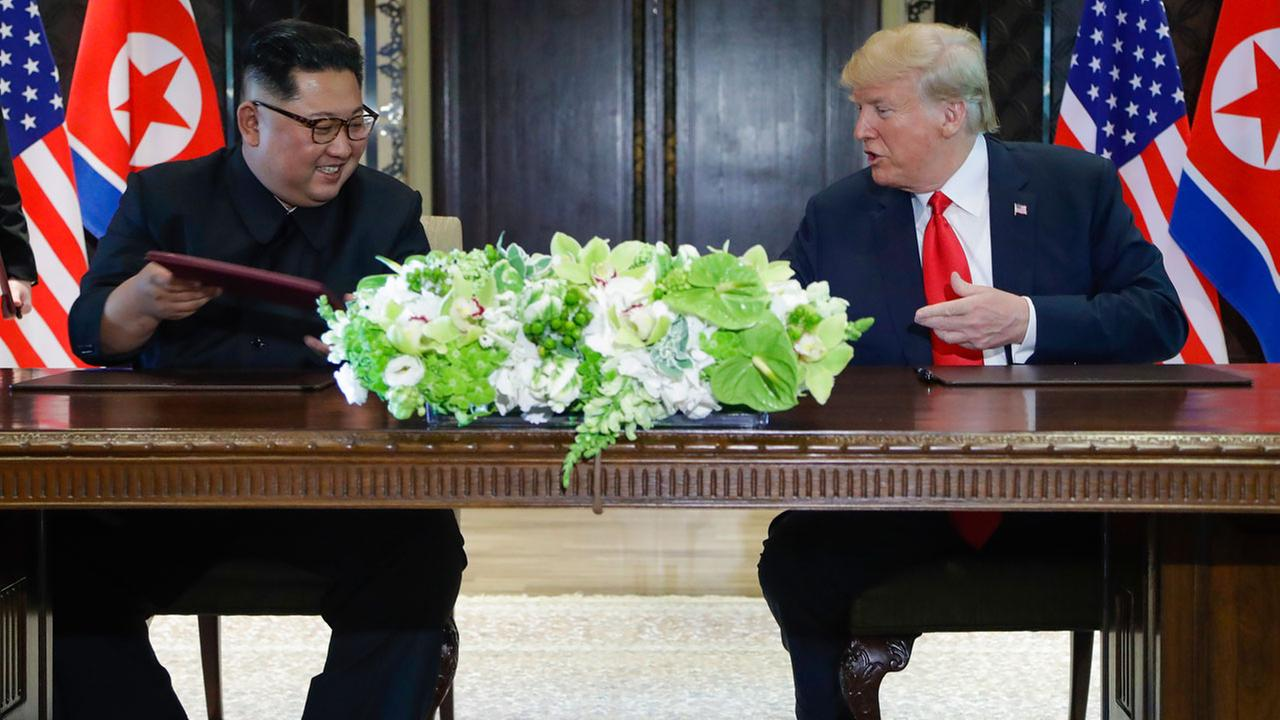 North Korea leader Kim Jong Un and U.S. President Donald Trump exchanged signed documents at the Capella resort on Sentosa Island Tuesday, June 12, 2018 in Singapore.