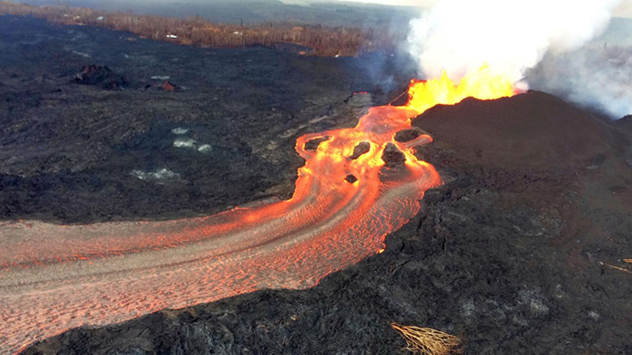 In this Sunday, June 10, 2018 photo from the U.S. Geological Survey, fissure 8 below Kilauea Volcano continues to erupt vigorously with lava streaming into the ocean.
