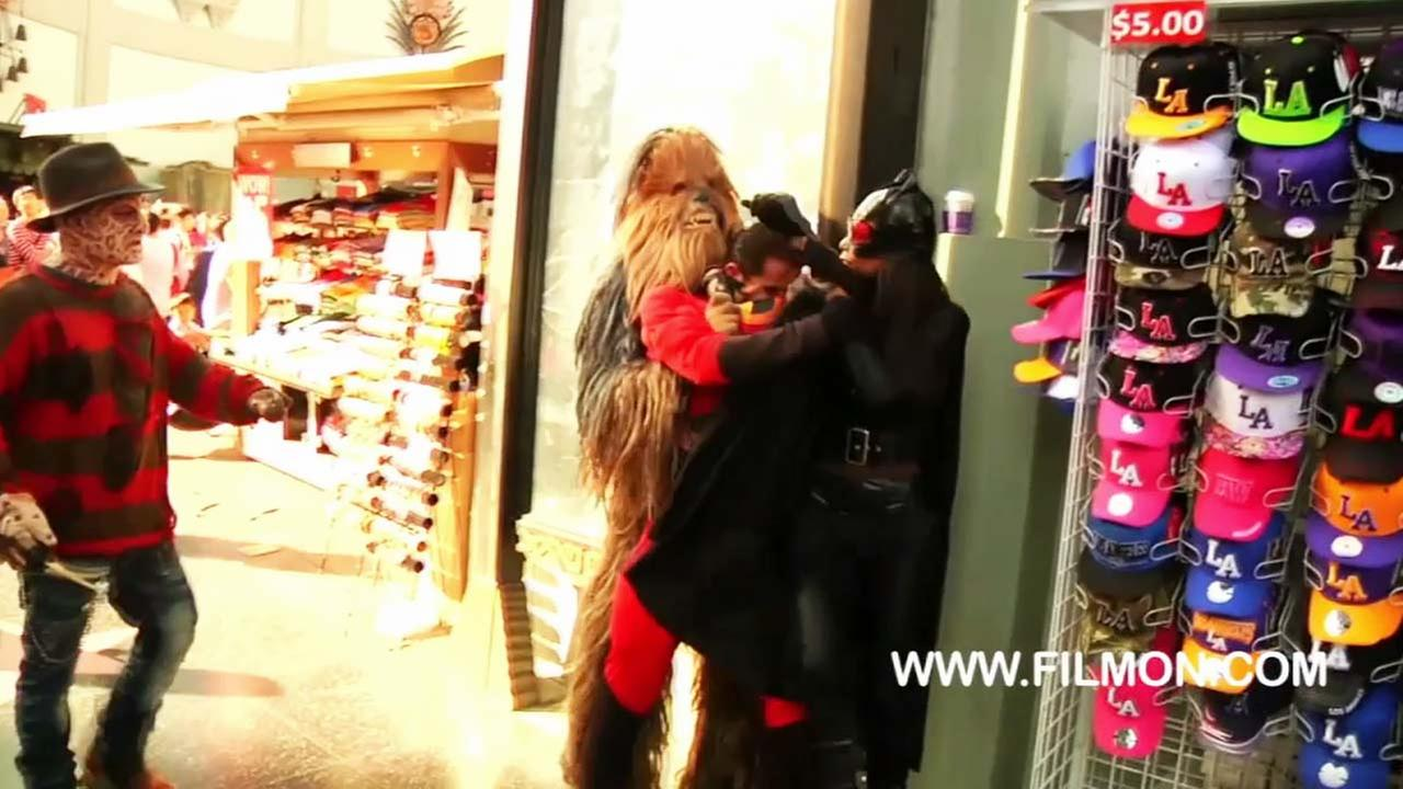 This still image from FilmOn.com shows costumed characters on Hollywood Boulevard getting into a brawl on Tuesday, Oct. 21, 2014.