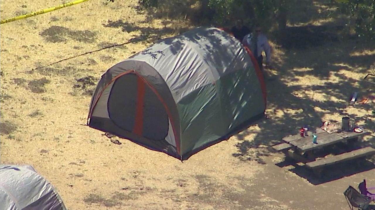A campsite in Calabasas where a man was fatally shot while camping with his family is taped off while Los Angeles County sheriffs investigators look into the crime.