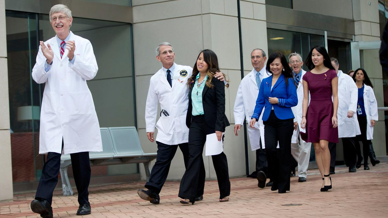 Nina Pham is escorted out by Dr. Anthony Fauci outside of National Institutes of Health (NIH) in Bethesda, Md., Friday, Oct. 24, 2014.