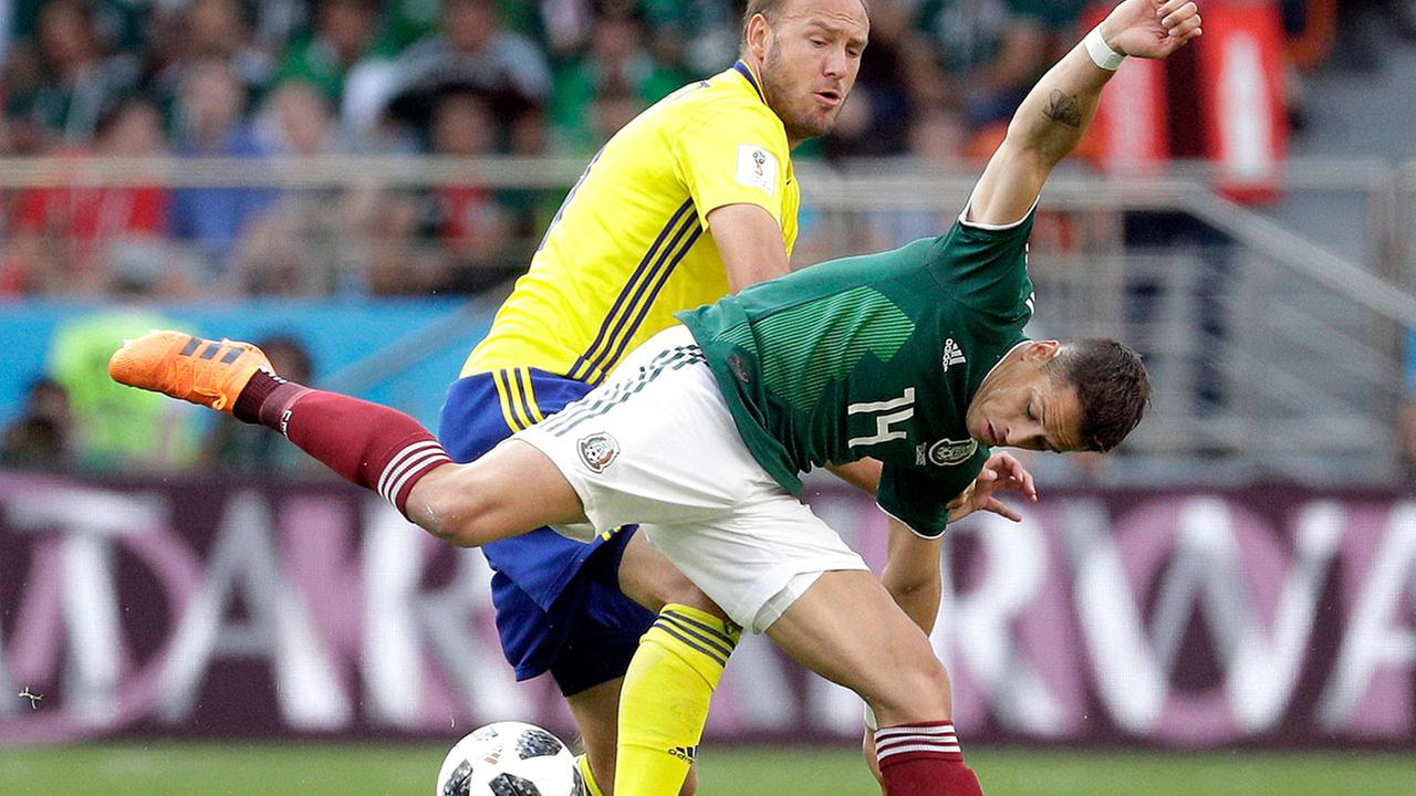 Swedens Andreas Granqvist and Mexicos Javier Hernandez challenge for the ball at the 2018 soccer World Cup in Russia, Wednesday, June 27, 2018.