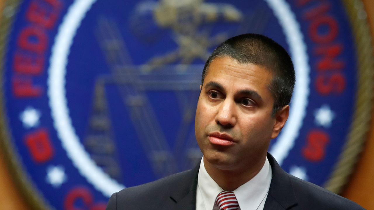 FILE - In this Dec. 14, 2017 file photo, Federal Communications Commission (FCC) Chairman Ajit Pai arrives for an FCC meeting.