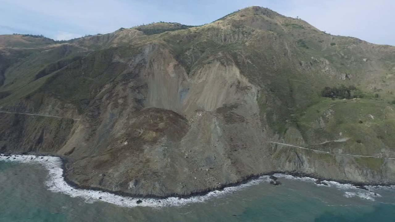 A stretch of Highway 1 is seen buried under a massive landslide.