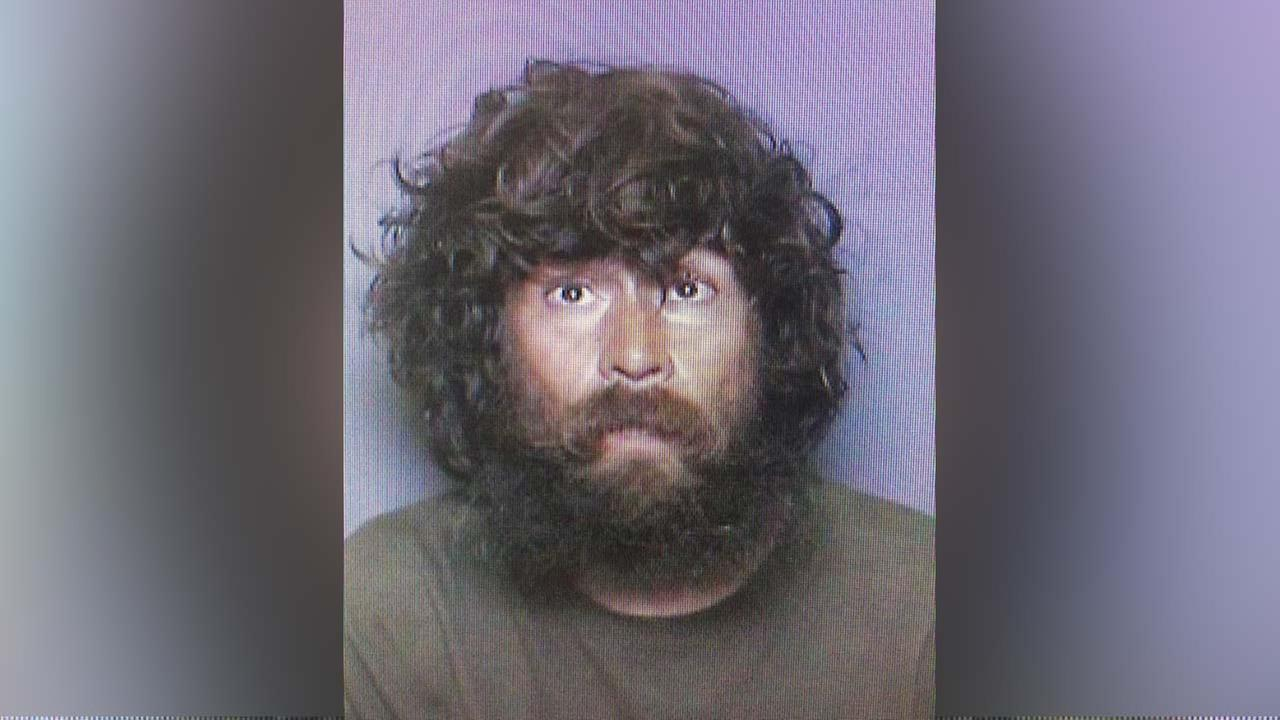 Robert Jensen, 39, is seen in a booking photo provided by the Placentia Police Department.